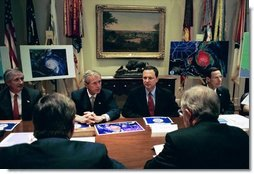 President George W. Bush receives a briefing on Hurricane Isabel in the Roosevelt Room Wednesday, Sept. 17, 2003. White House photo by Paul Morse
