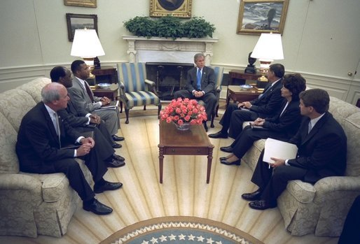 President George W. Bush discusses faith-based administrative reforms with Cabinet Members in the Oval Office Monday, Sept. 22, 2003. They are, from left, Deputy Secretary of Education Eugene Hickok, Deputy Secretary of Veterans Affairs Leo Mackay, Deputy Secretary of Health and Human Services Claude Allen, Secretary of Housing and Urban Development Mel Martinez, Secretary of Labor Elaine Chao, and Director of USA Freedom Corps John Bridgeland. White House photo by Eric Draper