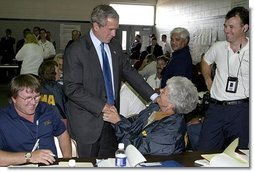 "After delivering remarks about Hurricane Isabel, President George W. Bush personally thanks FEMA staff at the temporary operations center housed at the Virginia State Police Academy in Richmond, Va., Monday, Sept. 22, 2003. ""There's a lot of neighborliness taking place in the state of Virginia and North Carolina and Maryland, where if somebody hurts and somebody's lonely, somebody needs help is finding refuge and solace because a fellow citizen has taken it upon him or herself to help somebody in need,"" said the President.  White House photo by Paul Morse"