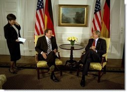 "President George W. Bush talks with German Chancellor Gerhard Schroeder during a series of United Nations meetings with world leaders in New York Wednesday, Sept. 24, 2003. After the meeting, the two leaders addressed the media. ""We're both committed to freedom; we're both committed to peace; we're both committed to the prosperity of our people,"" said President Bush.  White House photo by Paul Morse"