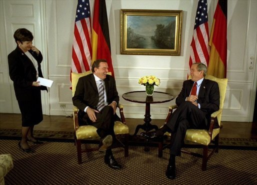 "President George W. Bush talks with German Chancellor Gerhard Schroeder during a series of United Nations meetings with world leaders in New York Wednesday, Sept. 24, 2003. After the meeting, the two leaders addressed the media. ""We're both committed to freedom; we're both committed to peace; we're both committed to the prosperity of our people,"" said President Bush. White House photo by Paul Morse."