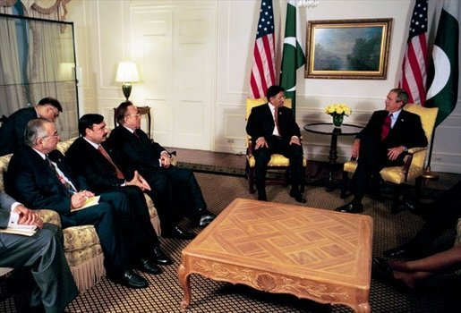 President George W. Bush talks with President Pervez Musharraf of Pakistan during a series of United Nations meetings with world leaders in New York Wednesday, Sept. 24, 2003. White House photo by Paul Morse.