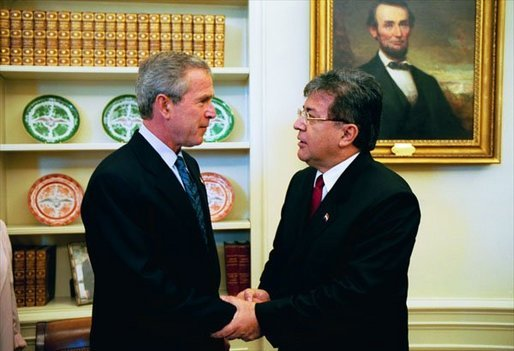 President George W. Bush and President Nicanor Duarte of Paraguay talk in the Oval Office Friday, Sept. 26, 2003. White House photo by Tina Hager