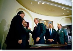 President George W. Bush signs the Do Not Call Registry in the Roosevelt Room Sept. 29, 2003. Pictured with the President are, from left, Rep. Edward Markey, D-Mass.; Rep. Fred Upton, R-Mich.; Federal Trade Commission Chairman Timothy Muris; Rep. Billy Tauzin, R-La. (behind President Bush); Federal Communications Commission Chairman Michael Powell; and Sen. Ted Stevens, R-Alaska.  White House photo by Eric Draper