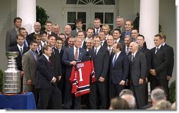 President George W. Bush poses with the 2003 Stanley Cup Champion New Jersey Devils ice hockey team Monday afternoon, September 29, 2003, in the Rose Garden.  White House photo by Jennifer Smith