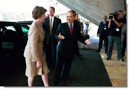 Laura Bush is welcomed to UNESCO headquarters in Paris by UNESCO director Koichiro Matsuura for formal ceremonies celebrating the renewed participation of the United States Sept. 9, 2003.  White House photo by Susan Sterner
