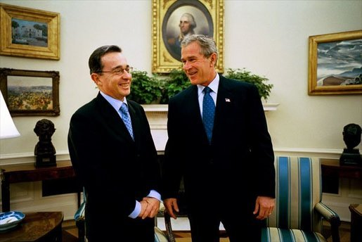 President George W. Bush hosts a visit by Colombian President Alvaro Uribe to the Oval Office Wednesday, Oct. 1, 2003. White House photo by Eric Draper.