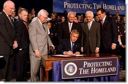 "President George W. Bush signs the Homeland Security Appropriations Act of 2004 at the Department of Homeland Security in Washington, D.C., Wednesday, Oct. 1, 2003. ""The Homeland Security bill I will sign today commits $31 billion to securing our nation, over $14 billion more than pre-September 11th levels. The bill increases funding for the key responsibilities at the Department of Homeland Security and supports important new initiatives across the Department,"" said the President in his remarks.  White House photo by Tina Hager"