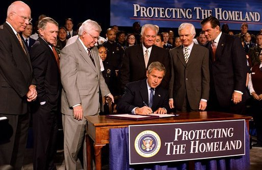 "President George W. Bush signs the Homeland Security Appropriations Act of 2004 at the Department of Homeland Security in Washington, D.C., Wednesday, Oct. 1, 2003. ""The Homeland Security bill I will sign today commits $31 billion to securing our nation, over $14 billion more than pre-September 11th levels. The bill increases funding for the key responsibilities at the Department of Homeland Security and supports important new initiatives across the Department,"" said the President in his remarks. White House photo by Tina Hager."