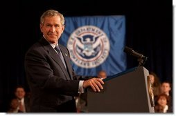 "President George W. Bush addresses employees at the Department of Homeland Security in Washington, D.C., Wednesday, Oct. 1, 2003. ""The danger to America gives all of you an essential role in the war on terror,"" said the President. ""You've done fine work under difficult and urgent circumstances, and on behalf of a grateful nation, I thank you all for what you do for the security and safety of our fellow citizens.""  White House photo by Tina Hager"