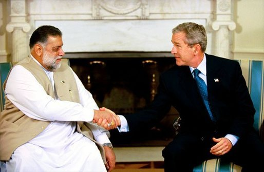 President George W. Bush meets with Prime Minister Mir Zafarullah Khan Jamali of Pakistan in the Oval Office Wednesday, Oct. 1, 2003. White House photo by Eric Draper.