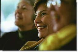 Laura Bush enjoys presentations by authors during the 2003 National Book Festival on the National Mall in Washington, D.C., Oct. 4, 2003.  White House photo by Susan Sterner