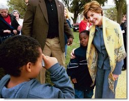 Mrs. Bush poses with children during her visit to the 2003 National Book Festival on the National Mall in Washington, D.C., Oct. 4, 2003.  White House photo by Susan Sterner