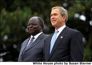 Presidents Bush and Kibaki watch the military review portion of the State Arrival Ceremonies on the South Lawn of the White House Monday, October 5, 2003. White House photo by Susan Sterner. White House photo by Susan Sterner