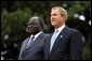 Presidents Bush and Kibaki watch the military review portion of the State Arrival Ceremonies on the South Lawn of the White House Monday, October 5, 2003.  White House photo by Susan Sterner
