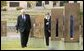 Vice President Dick Cheney walks with Don Ferrell (not pictured) through the Field of Empty Chairs to the chair of Susan Ferrell, Don Ferrell's daughter, at the Oklahoma City National Memorial in Oklahoma City, Okla., Oct. 9, 2003. The field contains 168 chairs, one for each person who died in the bombing of the Federal Building. White House photo by David Bohrer.