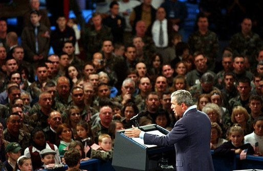 "President George W. Bush delivers remarks to the New Hampshire Air National Guard, Army National Guard, Reservists and their families at Pease Air National Guard Base in Portsmouth, N.H., Thursday, Oct. 9, 2003. ""Militia and volunteers and guardsmen have served from the Revolution to the Civil War, to World War II, to Desert Storm. Honor and service and courage are great New Hampshire traditions, and you're upholding those traditions,"" said the President in his remarks. White House photo by Tina Hager"
