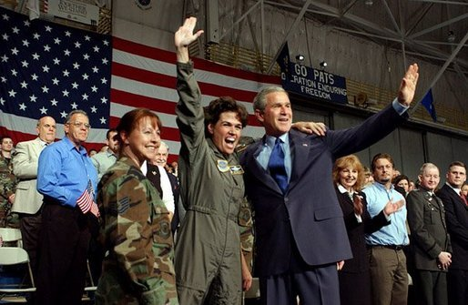 President George W. Bush is welcomed by a member of the New Hampshire Air National Guard at Pease Air National Guard Base in Portsmouth, N.H., Thursday, Oct. 9, 2003. White House photo by Tina Hager