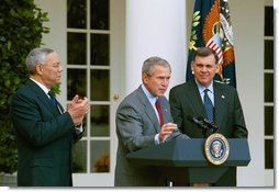"President George W. Bush discusses America's policies regarding Cuba as Secretary of State Colin Powell, left, and Secretary of Housing and Urban Development Mel Martinez stand by his side in the Rose Garden Friday, Oct. 10, 2003. ""We will increase the number of new Cuban immigrants we welcome every year,"" said the President. ""We are free to do so, and we will, for the good of those who seek freedom. Our goal is to help more Cubans safely complete their journey to a free land.""  White House photo by Tina Hager"