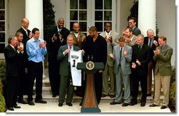 President George W. Bush holds up a jersey presented to him during a ceremony welcoming the 2003 NBA Champion San Antonio Spurs in The Rose Garden Tuesday, Oct. 14, 2003.  White House photo by Paul Morse