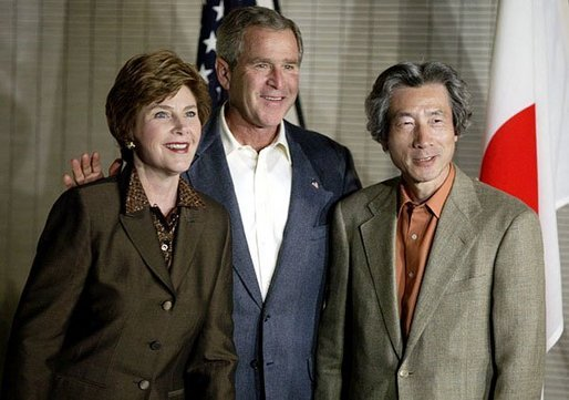 Photo.President George W. Bush and Laura Bush stand with Japanese Prime Minister Junichiro Koizumi before meeting for dinner in Tokyo during the first stop of the President's trip to Asia and Australia Thursday, Oct. 16, 2003. White House photo by Paul Morse