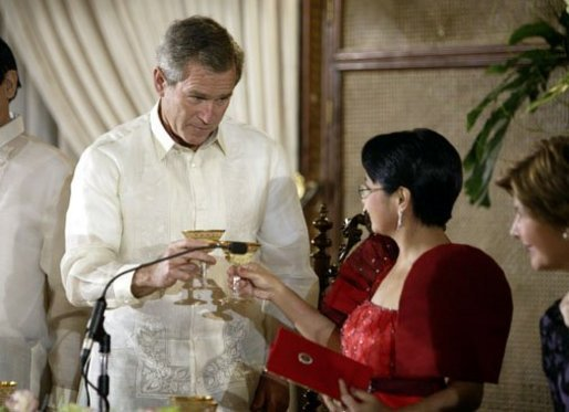 President George W. Bush toasts Philippine President Gloria Arroyo during a state dinner in Manila, Philippines, Saturday, Oct. 18, 2003. White House photo by Paul Morse