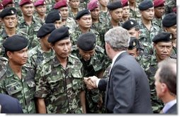 President George W. Bush greets Thai troops after his remarks at the Royal Thai Army Headquarters in Bangkok, Thailand, Sunday, Oct. 19, 2003.  White House photo by Paul Morse