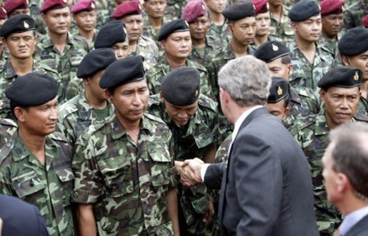 President George W. Bush greets Thai troops after his remarks at the Royal Thai Army Headquarters in Bangkok, Thailand, Sunday, Oct. 19, 2003. White House photo by Paul Morse.