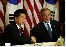 President George W. Bush and South Korean President Roh Moo-Hyun meet for a working breakfast in Bangkok, Thailand, Oct. 20, 2003.  White House photo by Paul Morse
