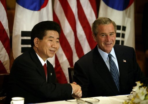 President George W. Bush and South Korean President Roh Moo-Hyun meet for a working breakfast in Bangkok, Thailand, Oct. 20, 2003. White House photo by Paul Morse.