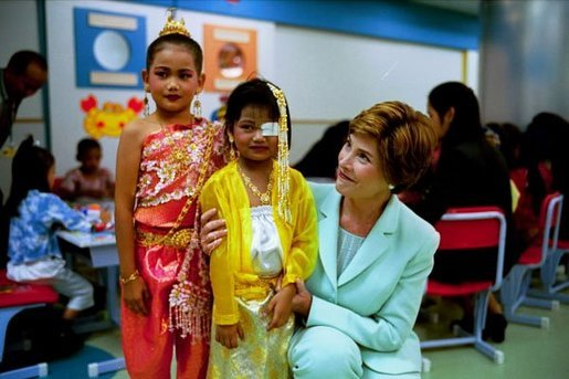 Laura Bush embraces a little girl at the National Institute of Child Health in Bangkok, Thailand, Oct. 21, 2003. White House photo by Tina Hager.