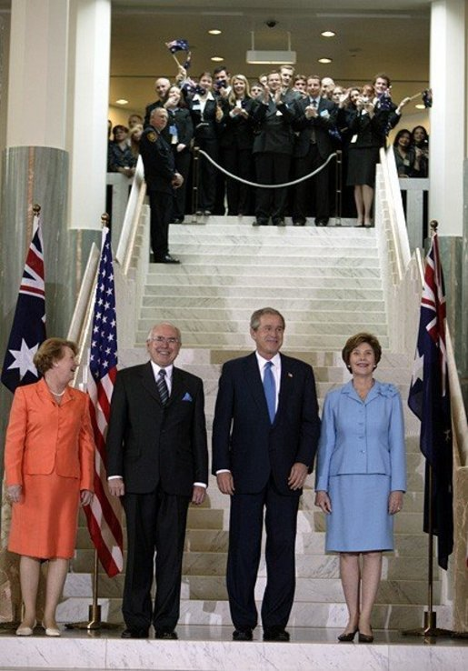 President George W. Bush and Laura Bush stand with Australian Prime Minister John Howard and his wife Jannette Howard at the Parliament House in Canberra, Australia, Oct. 23, 2003. White House photo by Paul Morse