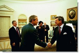 "Discussing the progress in Iraq, President George W. Bush meets with Ambassador L. Paul Bremer, Presidential Envoy to Iraq, in the Oval Office Monday, Oct. 27, 2003. ""Well, a lot of wonderful things have happened in Iraq since July, as you mentioned,"" said Ambassador Bremer to the media. ""We have a cabinet now, with ministers actually conducting affairs of state. We have met all of our goals in restoring essential services. All the schools and hospitals are open. Electricity is back at pre-war levels.""  White House photo by Tina Hager"