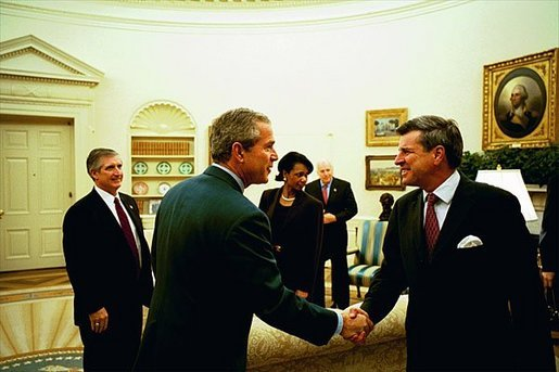 "Discussing the progress in Iraq, President George W. Bush meets with Ambassador L. Paul Bremer, Presidential Envoy to Iraq, in the Oval Office Monday, Oct. 27, 2003. ""Well, a lot of wonderful things have happened in Iraq since July, as you mentioned,"" said Ambassador Bremer to the media. ""We have a cabinet now, with ministers actually conducting affairs of state. We have met all of our goals in restoring essential services. All the schools and hospitals are open. Electricity is back at pre-war levels."" White House photo by Tina Hager."