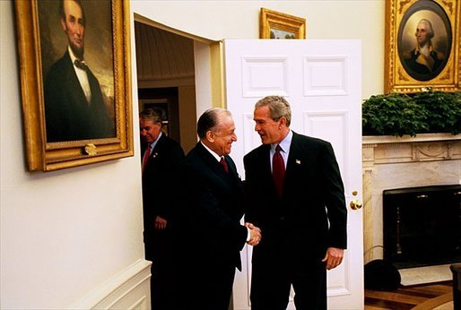 President George W. Bush welcomes Romanian President Ion Iliescu to the Oval Office Tuesday, Oct. 28, 2003. White House photo by Tina Hager.