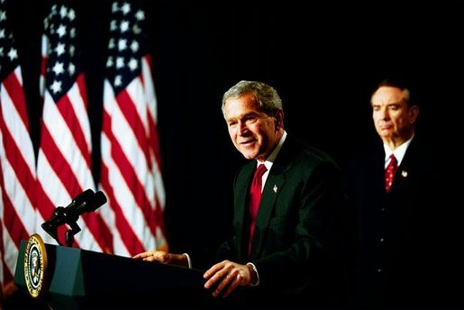 "As Health and Human Services Secretary Tommy Thompson stands by, President George W. Bush discusses Medicare in the Dwight D. Eisenhower Executive Office Building Tuesday, Oct. 29, 2003. ""The best way to provide our seniors with modern medicine, including prescription drug coverage and better preventative care, is to give them better choices under Medicare,"" said the President talking about pending Medicare legislation White House photo by Tina Hager"