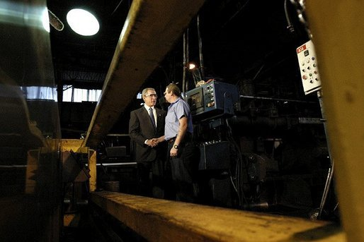 "President George W. Bush greets employee Bill Haines during a tour of the Central Aluminum Company in Columbus, Ohio, Thursday, Oct. 30, 2003. ""Congress needs to pass a sound energy plan to help deal with the issues that confront this good company, Central Aluminum,"" said President Bush during his remarks on energy at the company. White House photo by Eric Draper"