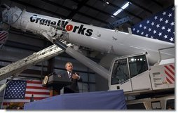 President George W. Bush delivers remarks on the economy at CraneWorks' equipment warehouse in