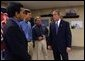 President George W. Bush meets with small business owners during a visit to CraneWorks' equipment warehouse in Birmingham, Ala., Monday, Nov. 3, 2003. Pictured with President Bush are Rom Reddy, CEO of Nexcel Synthetics, left, and brothers David, center, and Steve Upton, President and Vice President of CraneWorks. White House photo by Eric Draper