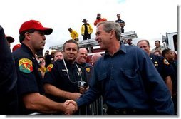President George W. Bush greets firefighters after speaking in El Cajon, Calif., Tuesday, Nov. 4, 2003  White House photo by Eric Draper