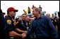 President George W. Bush greets firefighters after speaking in El Cajon, Calif., Tuesday, Nov. 4, 2003 White House photo by Eric Draper.