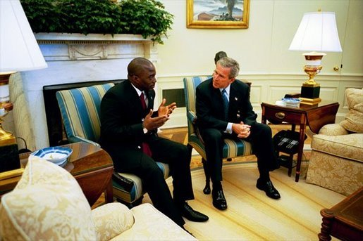 President George W. Bush meets with President Joseph Kabila of the Democratic Republic of the Congo in the Oval Office Wednesday, Nov. 5, 2003. The two leaders discussed a range of issues, including regional stability, trade and development, HIV/AIDS and the war on terrorism. White House photo by Paul Morse