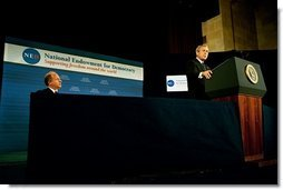 President George W. Bush delivers remarks at the 20th Anniversary of the National Endowment for Democracy at the U. S. Chamber of Commerce Thursday, Nov. 6, 2003. Pictured with President Bush is Vin Weber, the endowment's chair and former Congressman from Minnesota.