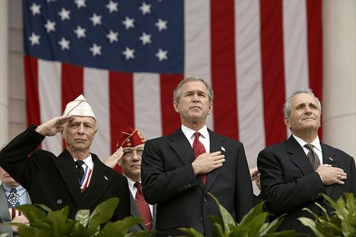 "President George W. Bush stands with National Commander of the Army and Navy Union David Berger, left, and Secretary of Veterans Affairs Anthony Principi during the Veterans Day ceremonies at Arlington National Cemetery Tuesday, Nov. 11, 2003. ""We observe Veterans Day on an anniversary -- not of a great battle or of the beginning of a war, but of a day when war ended and our nation was again at peace,"" said the President. ""Ever since the Armistice of November the 11th, 1918, this has been a day to remember our debt to all who have worn the uniform of the United States."" White House photo by Paul Morse."