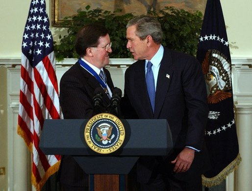 President George W. Bush congratulates NATO Secretary General Lord George Robertson after awarding him the Presidential Medal of Freedom during a ceremony in the Roosevelt Room Wednesday, Nov. 12, 2003. White House photo by Tina Hager.