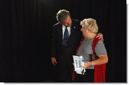 President George W. Bush embraces Loretta De Maintenon after meeting with seniors about his commitment to add prescription drug benefits to Medicare during a visit to Orlando, Fla., Thursday, Nov. 13, 2003.  White House photo by Tina Hager