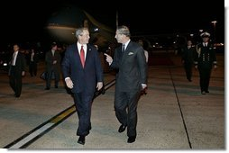 Arriving in London for a State Visit to the United Kingdom, President George W. Bush is greeted by Prince Charles at London Heathrow Airport Tuesday, Nov. 18, 2003. This State Visit is the first time an American President has visited as a guest of the Queen since President Reagan's visit in 1982.  White House photo by Eric Draper