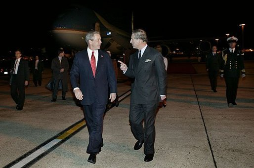 Arriving in London for a State Visit to the United Kingdom, President George W. Bush is greeted by Prince Charles at London Heathrow Airport Tuesday, Nov. 18, 2003. This State Visit is the first time an American President has visited as a guest of the Queen since President Reagan's visit in 1982. White House photo by Eric Draper.
