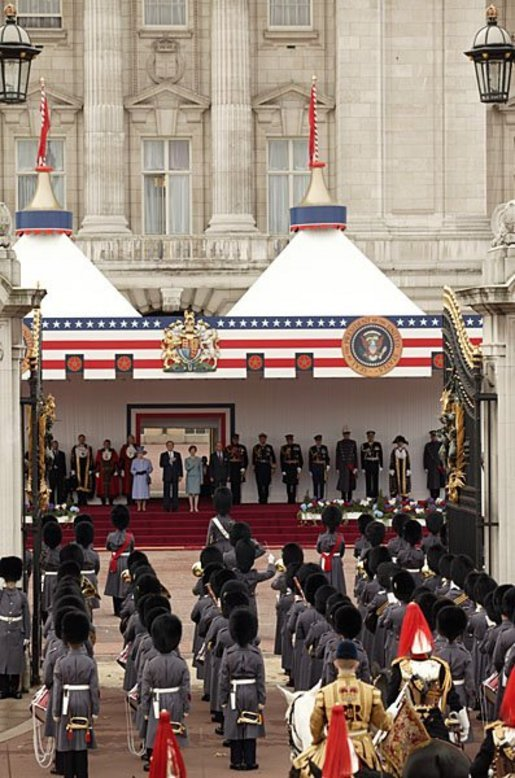President George W. Bush and Laura Bush listen to the playing of America's national anthem during an official welcome ceremony at Buckingham Palace in London, Wednesday, Nov. 19, 2003. Standing with them are Her Majesty Queen Elizabeth and Prince Philip, Duke of Edinburgh. The President and Mrs. Bush last visited Buckingham Palace July of 2001. White House photo by Paul Morse.