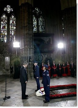 President George W. Bush bows his head in silence as a wreath is laid at the Tomb of the Unknown Warrior at Westminster Abbey in London Thursday, Nov. 20, 2003.  White House photo by Eric Draper
